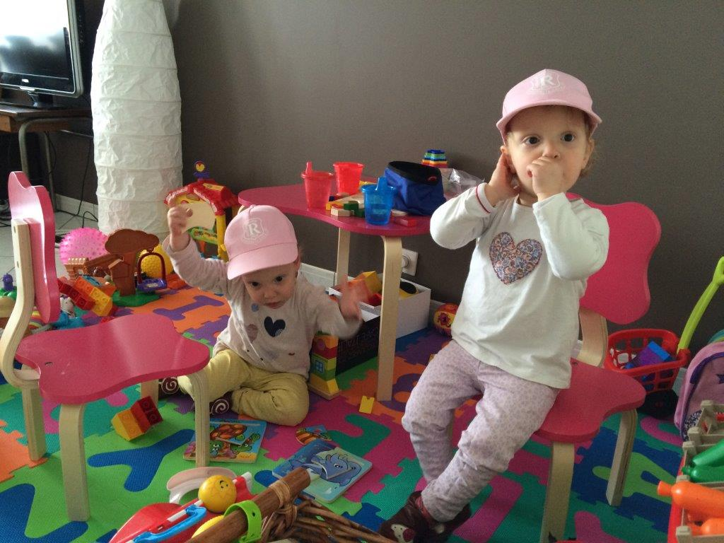 The twin girls of the FC Mantes tournament organizer receive a present from Ruislip Rangers