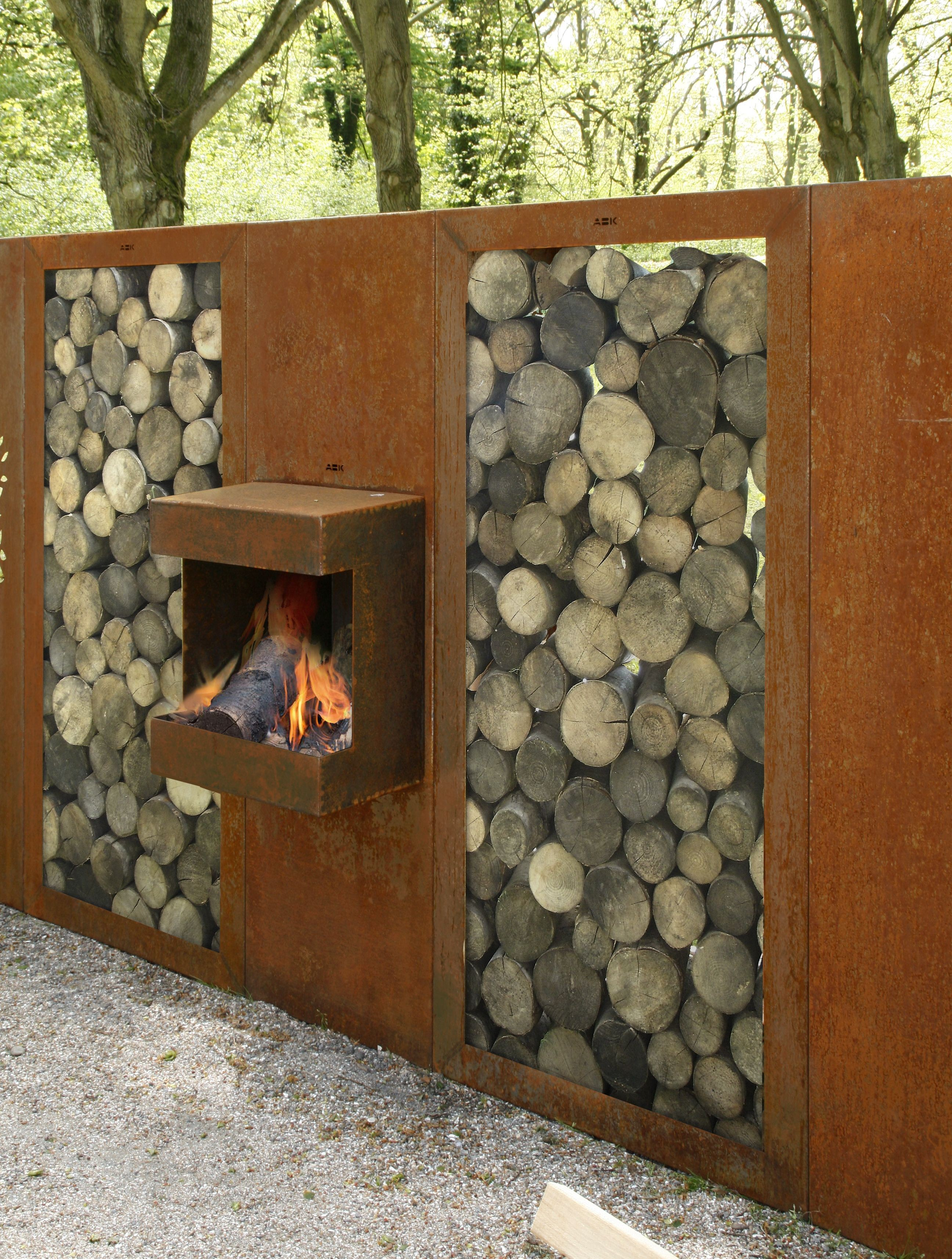 Corten steel fire place with wood storage abk outdoor