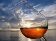 rum glass in the sunset