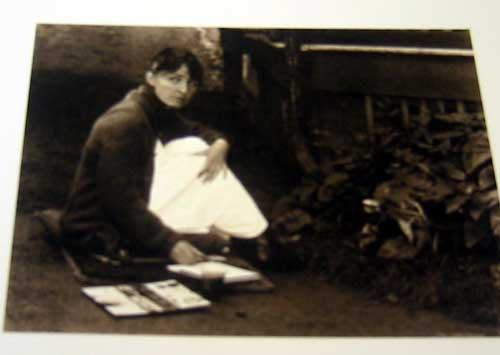 Georgia O'Keeffe working on her artwork