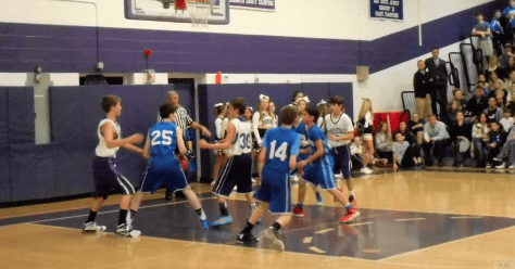 The boys' teams from Forrestdale and Holy Cross schools prepare for a rebound during the annual Basketball Fundraiser. Photo/Rumson School District