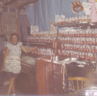 Millie Felsmann and her candy apples back in the 1960s Photo/courtesy of Monica Felsmann