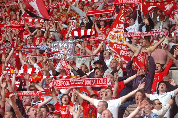 CARDIFF, WALES - SATURDAY, MAY 13th, 2006: Liverpool fans celebrate during the FA Cup Final against West Ham United at the Millennium Stadium. (Pic by Jason Roberts/Propaganda)