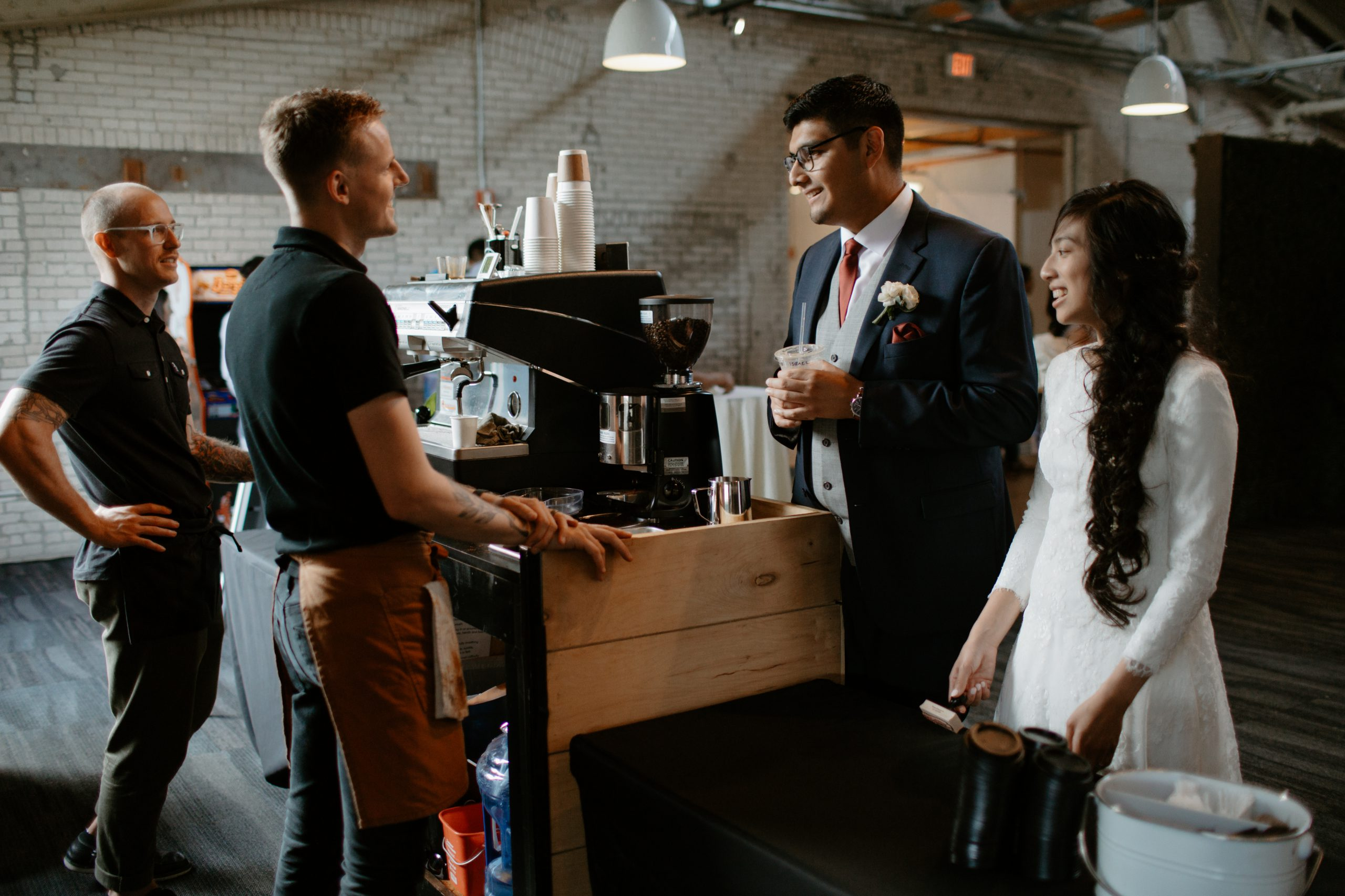 barista serving bride and groom
