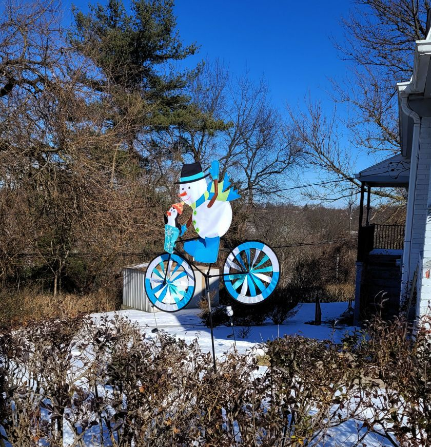Snowman on a bike wind catcher