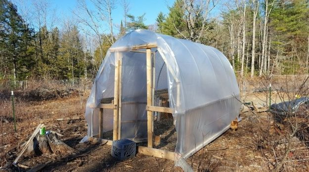 putting-plastic-on-hoop-house