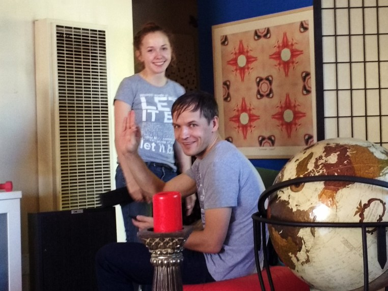 Masha & Artem sitting in the living room