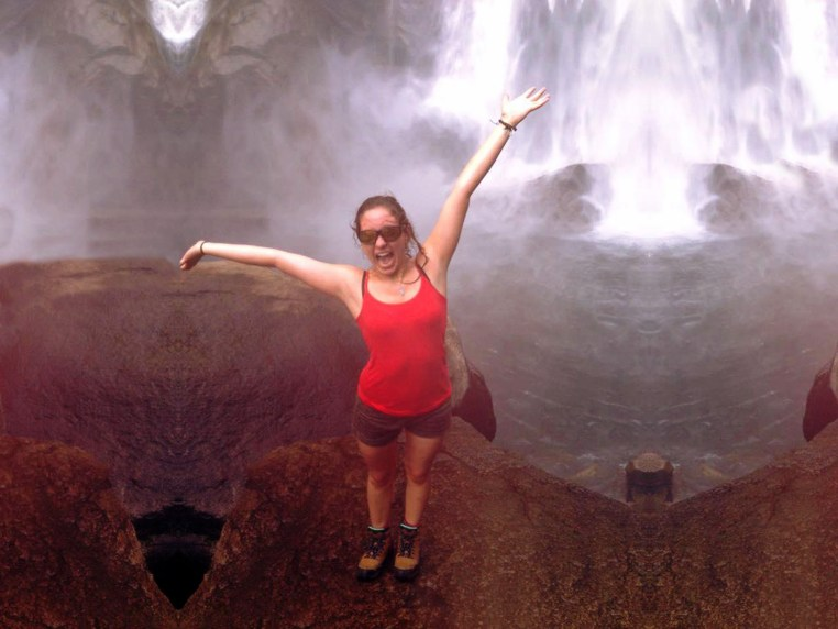 Blandine Amirault standing in front of a waterfall