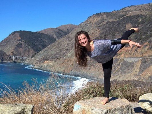 Terezia doing an arabesque on a rock by the rocky California coast