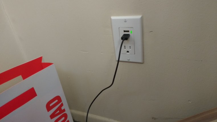 "photo of a USB connector plugged into a USB wall outlet in the ""Budapest Train Station"" room at Casa Glenn"