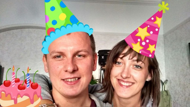 WhatsApp image of Czarek & Ida with cartoon party hats superimposed on their heads