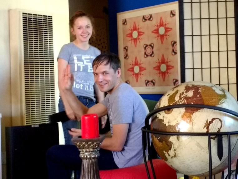 Masha & Artem sitting in the living room