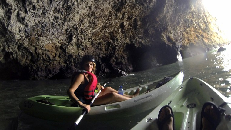 Stefanie Kuisle kayaks in a sea cave