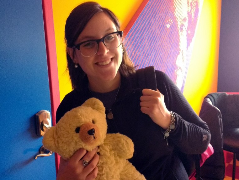 Ludmila Tugues of Argentina & the University of Nevada at Reno, holding a small teddy bear and smiling