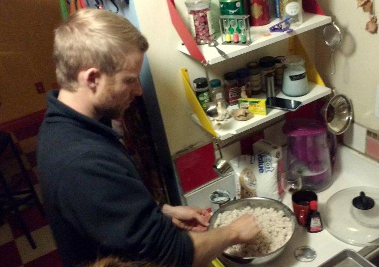 Mike stirring a big bowl full of stuff.