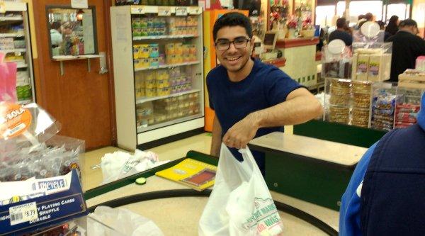 Davis at the checkout stand at Gonzalez Northgate market