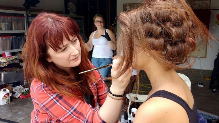 Sara Robey applying makeup to Carmen Lee Solomons