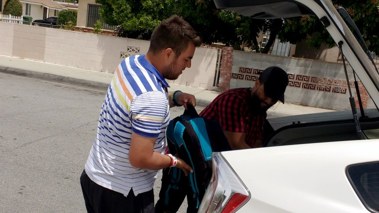 Daniel getting into an Uber car