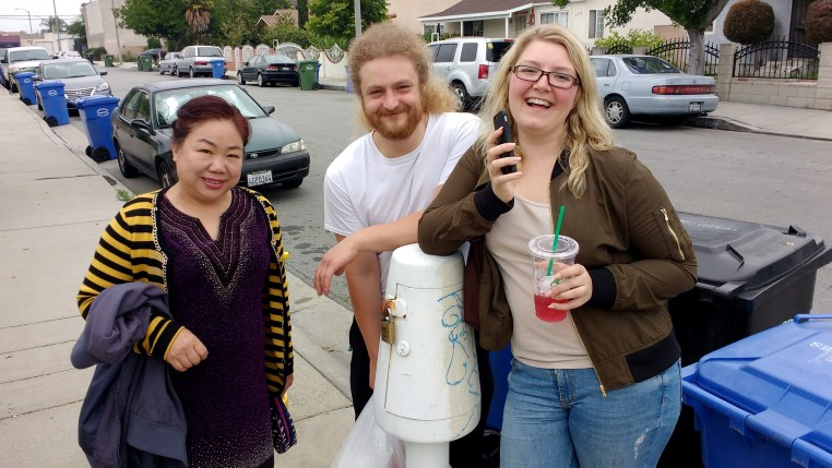 Xiaoyan, Andy & Tamara posing with a mysterious white object