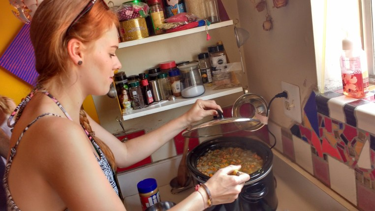 Paulina testing the soup.