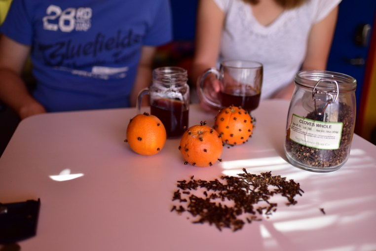 image of oranges and cloves on a table