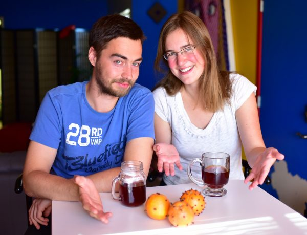 Patrick & MIo seated at a small table with several spiced oranges in front of them