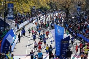 Runners celebrate the Finish of the 2014 TCS New York City Marathon. (Credit: Courtesy NYRR)