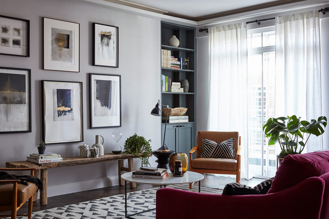 contemporary living room art stoves ireland regents park london apartment interiors design anna burles fresh cool modern frames wall rustic bench red couch light filled