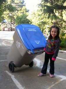 Girl pulling recycle bin