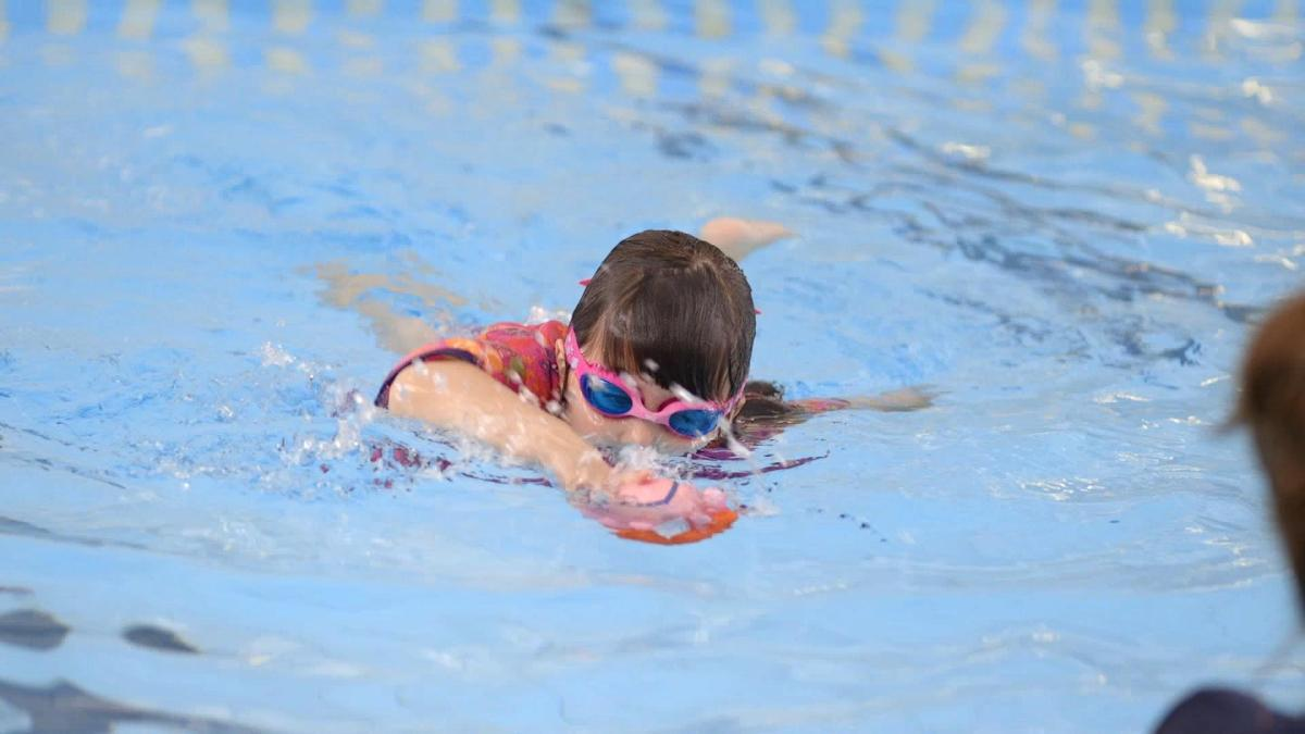 girl swimming with zoggs goggles
