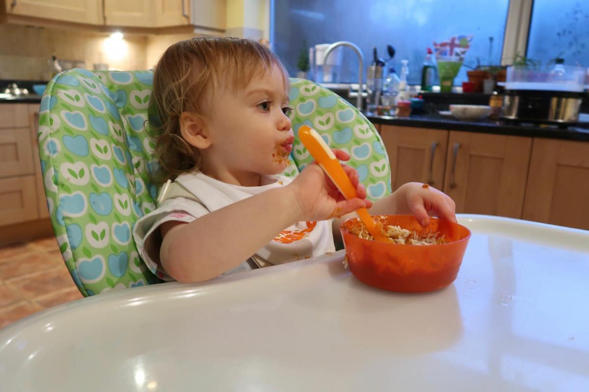 Baby eating For Aisha baby food