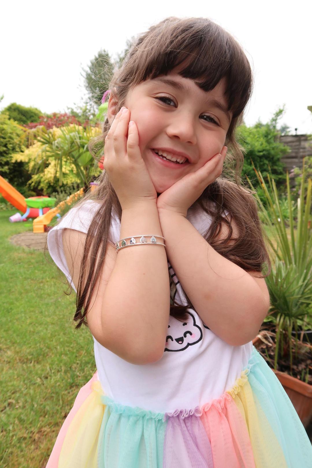 Girl wearing Molly Brown Her love bangle