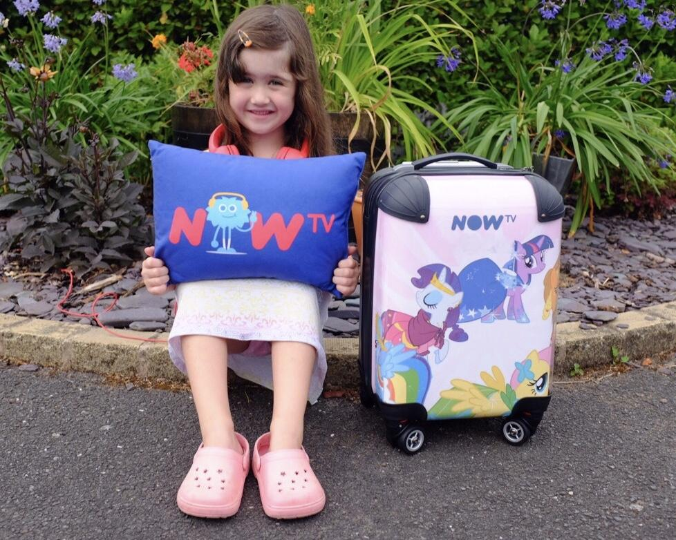 now tv pillow and suitcase