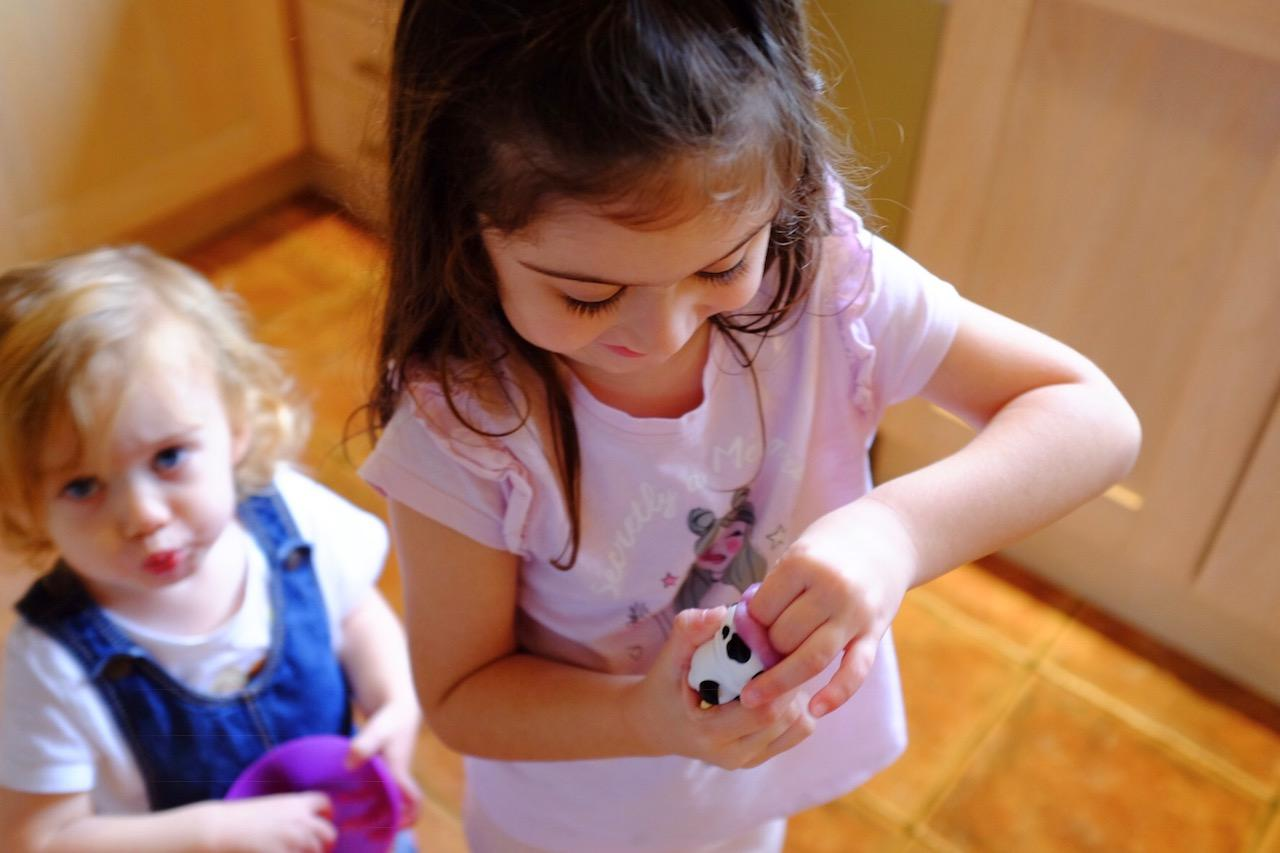 girl adding slime to collectable Poopsie Slime Surprise
