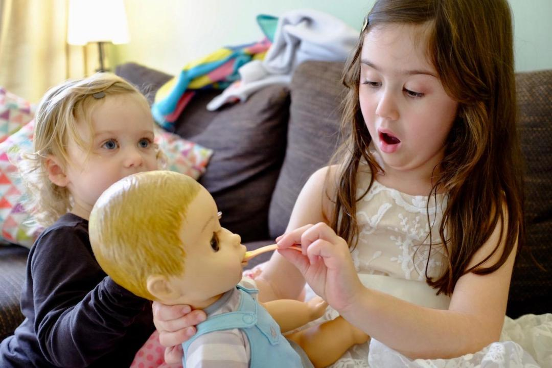 girl feeding Luvabeau doll