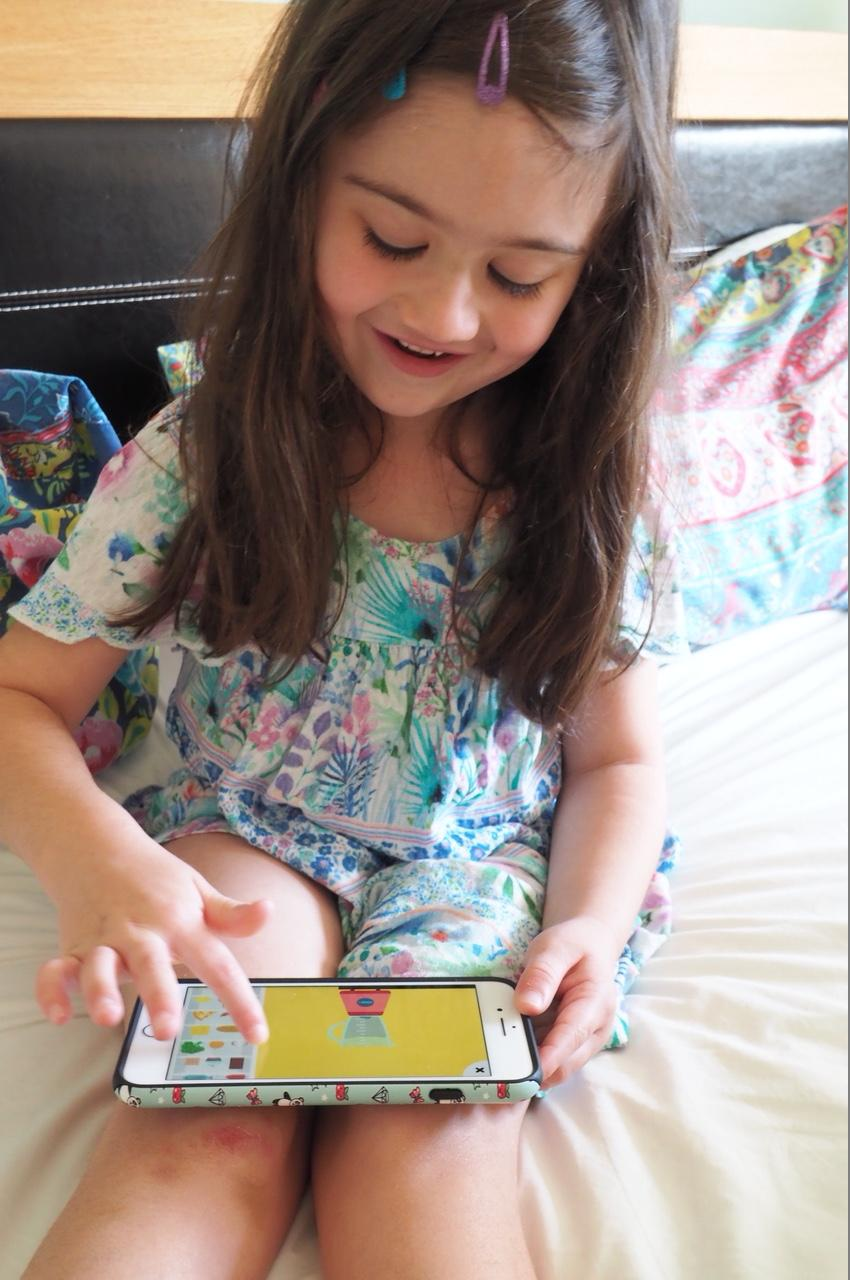 Happy girl playing The Fitoons App