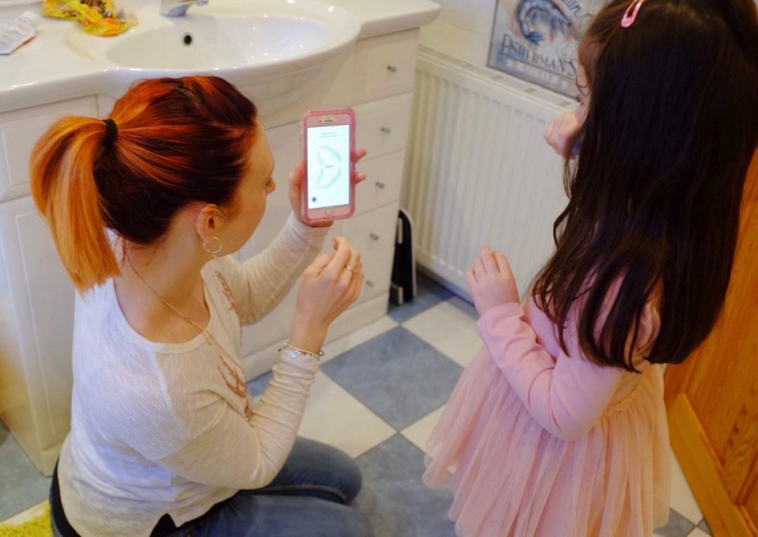 Mum and daughter using Playbrush
