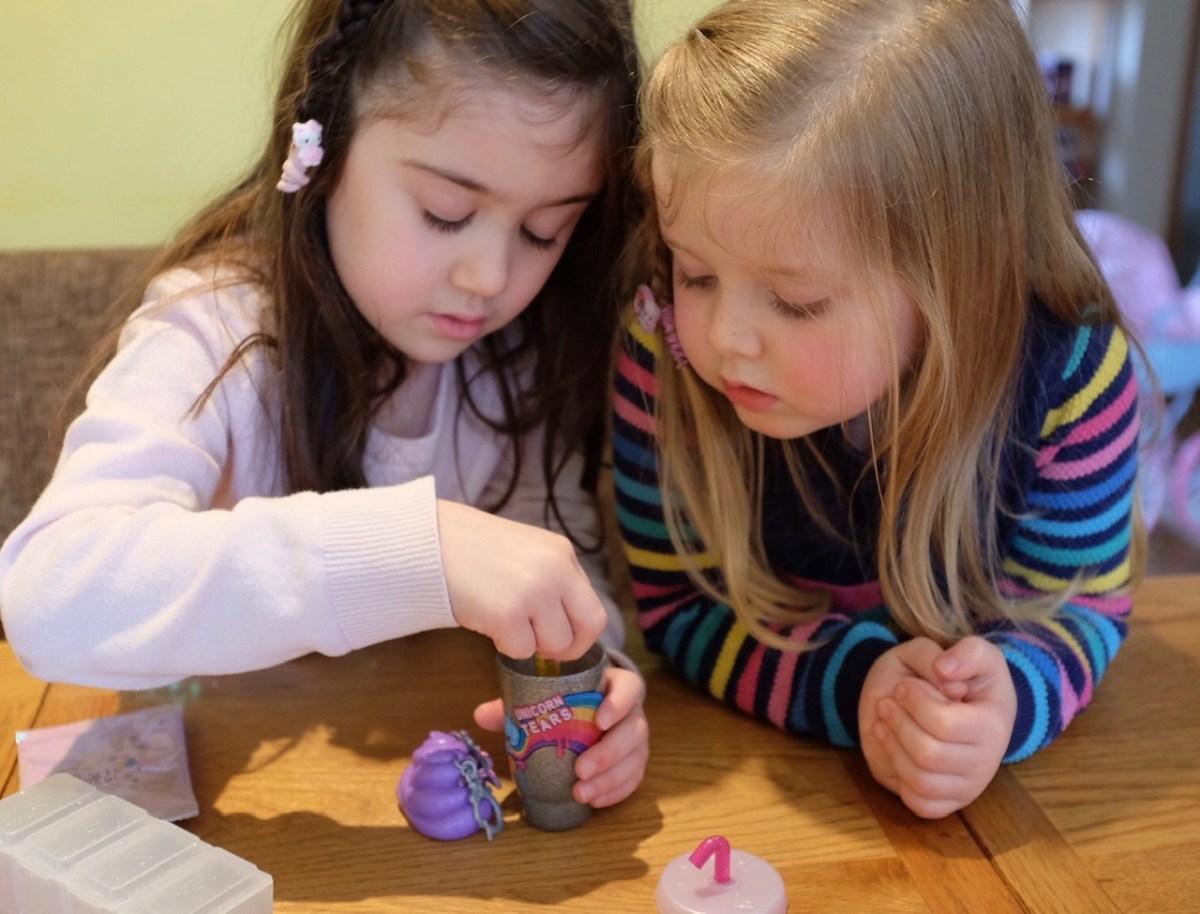 two girls making poopsie slime