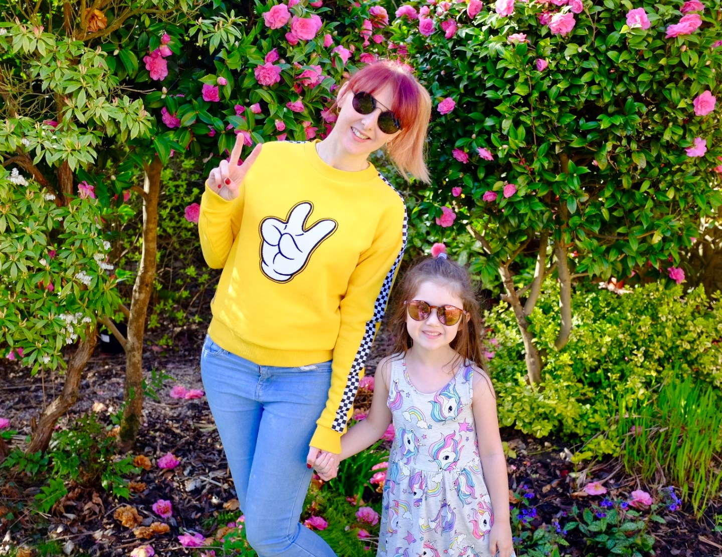 mum and daughter wearing a yellow Mickey shopDisney sweater