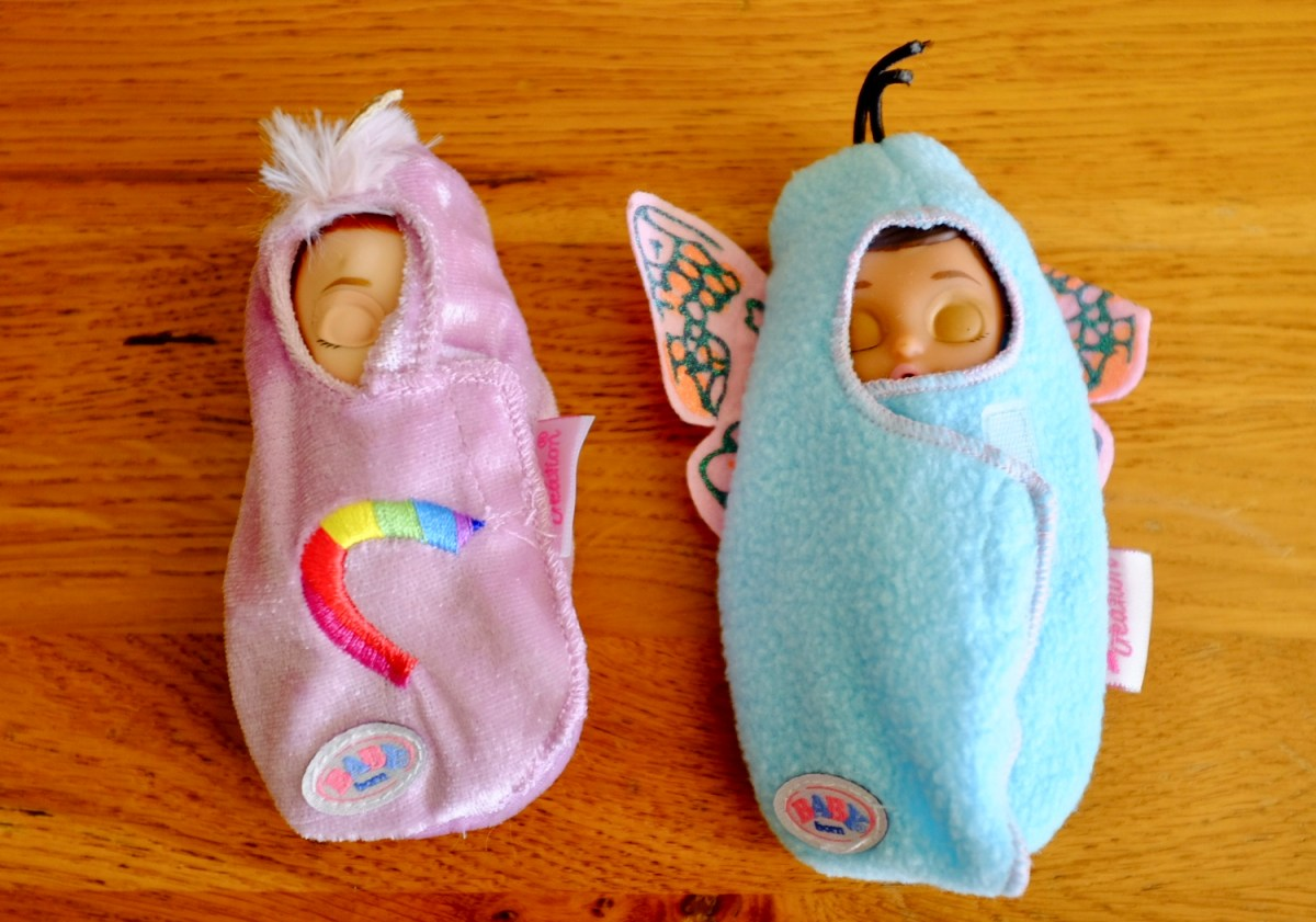 two swaddled babys