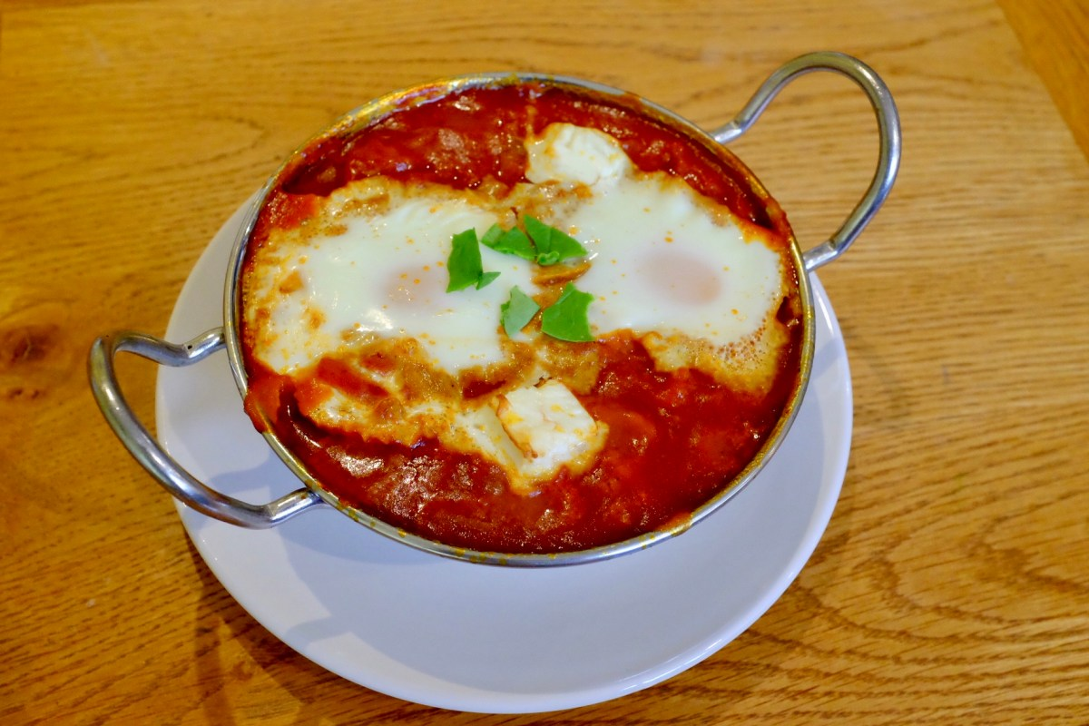 baked eggs served in a curry dish