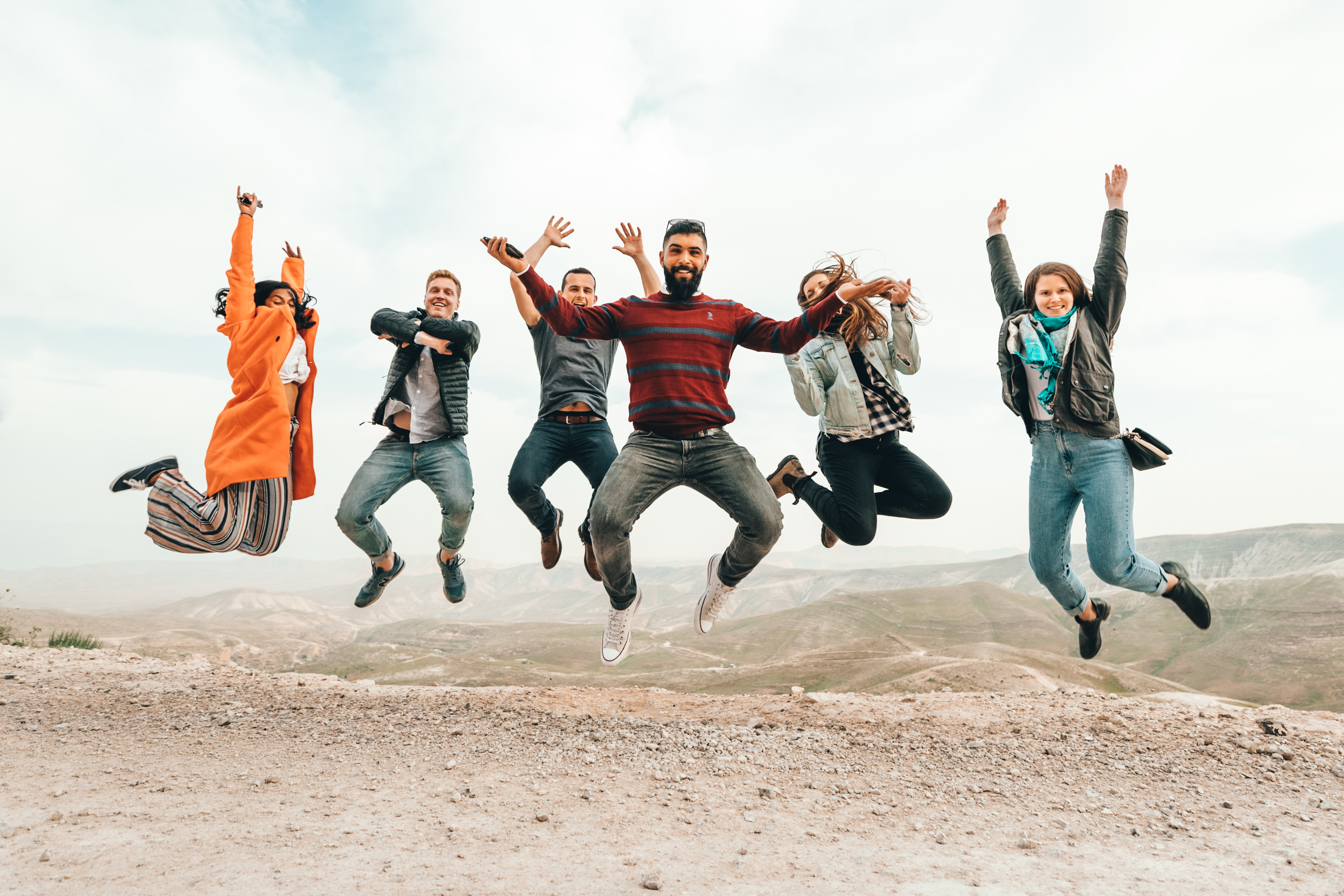 Group of people jumping in the air