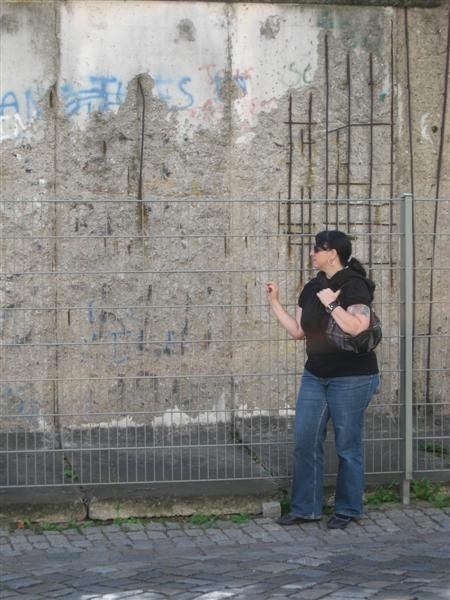 Standing at part of the former Berlin Wall.  2008.