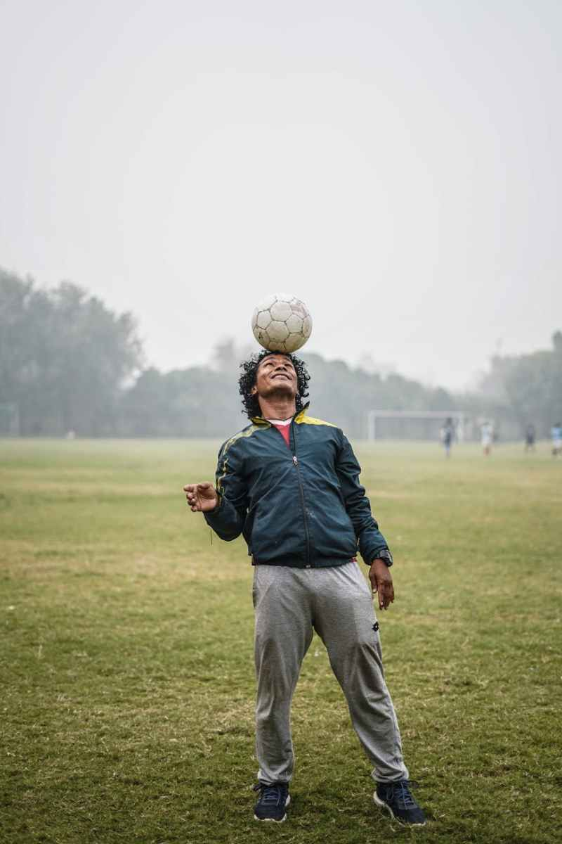 man doing tricks with soccer ball