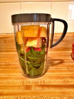 Spinach, pineapple and strawberry goes into the Bullet …