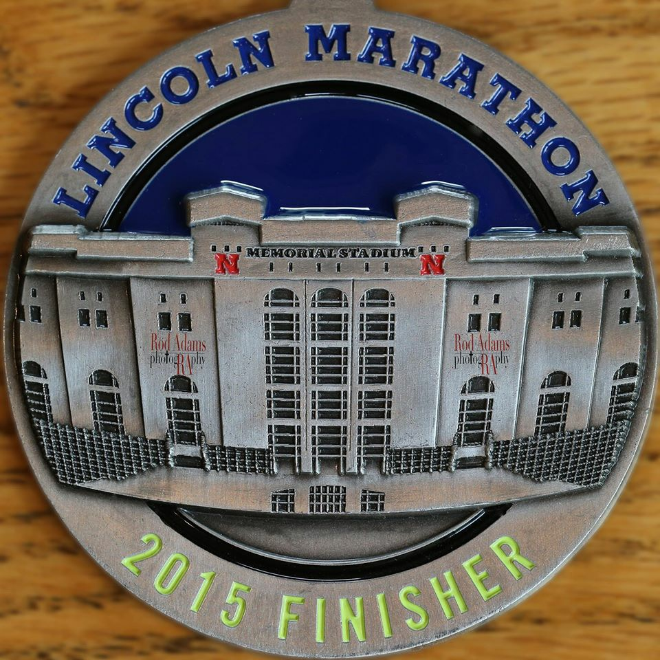 2015 Lincoln Marathon medal close-up featuring Memorial Stadium