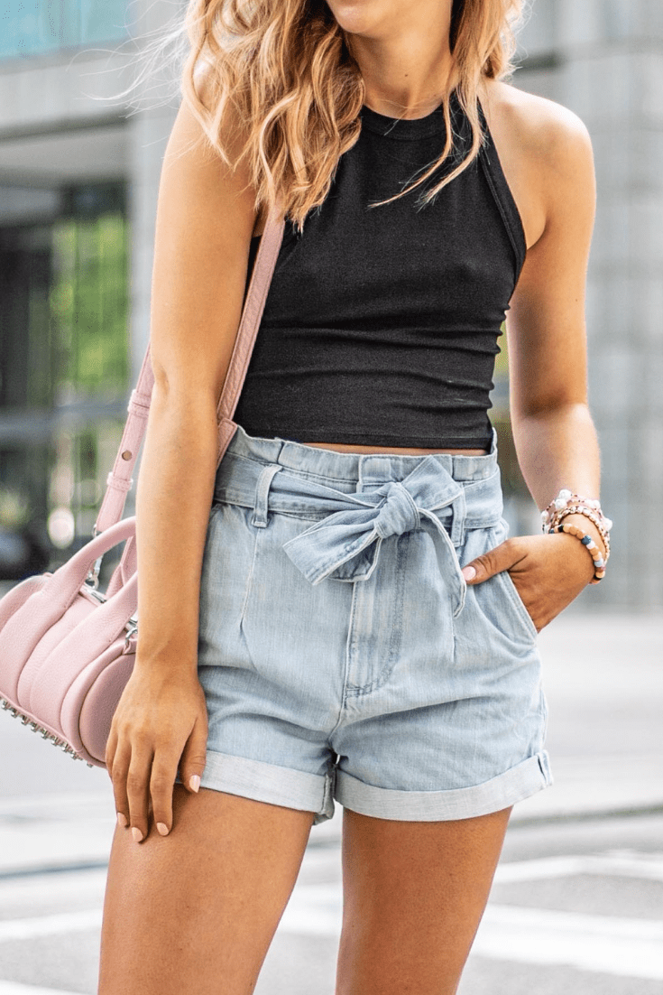 Easy summer style featured by top US fashion blog, Running in Heels: image of a woman wearing a black tank top and denim shorts.