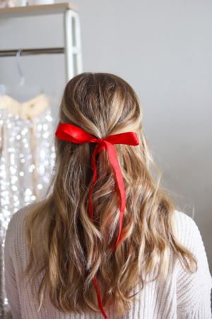 5 Festive Holiday Hairstyles for the Season featured by top Dallas beauty blogger, Running in Heels: little back with a bow