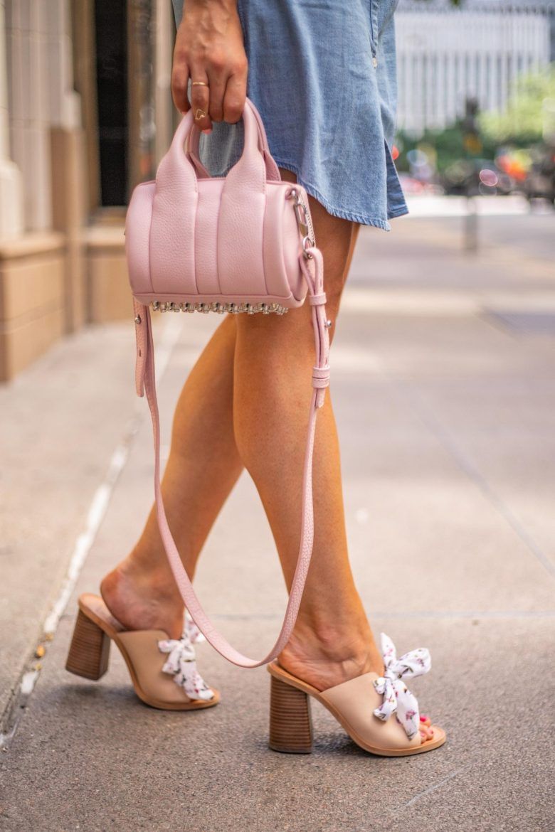 How to Style a Chambray Shirtdress, styling tips featured by top US fashion blog, Running in Heels: image of a woman wearing an Old Navy chambray shirtdress, and an Alexander Wang Rockie Baby bag.