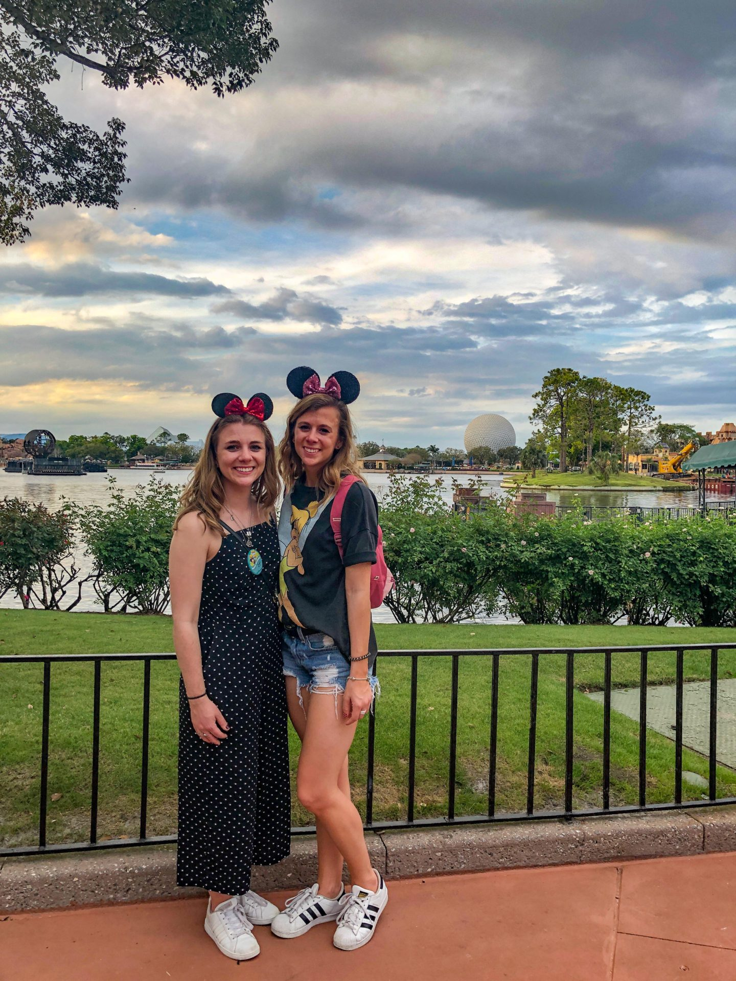 Adult Guide to Disney World Theme Parks Broken Down by Park | Running in Heels | Two sisters standing in Epcot at Disney World.